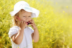 Laughing toddler in rape field Royalty Free Stock Photo