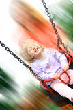 Laughing toddler on the swing Stock Photography