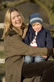 Laughing Together. A mother and her young son having fun out in the English countryside royalty free stock photography