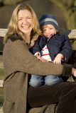 Laughing Together. A mother and her young son laughing together out in the English countryside royalty free stock photos
