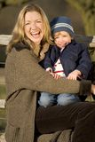 Laughing Together. A mother and her young son laughing together in the English countryside royalty free stock images