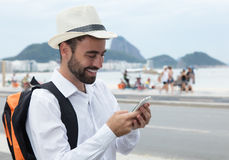 Laughing tourist looking for the right way at phone Royalty Free Stock Image