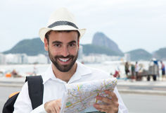 Laughing tourist with map at Rio de Janeiro Royalty Free Stock Photo
