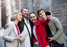 Laughing tourists shooting on cell phone Royalty Free Stock Photography