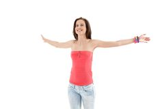 Laughing trendy girl with arms wide open. Laughing trendy girl standing with arms wide open happily, cutout on white background Royalty Free Stock Photography