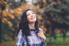 Laughing trendy girl in autumn park Stock Images