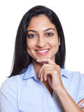 Laughing turkish businesswoman. With long black hair on an isolated white background for cutout Royalty Free Stock Image