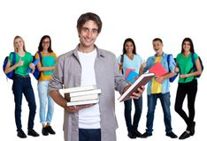 Laughing turkish young adult man with other students royalty free stock photos