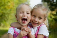 Laughing twins Royalty Free Stock Photography