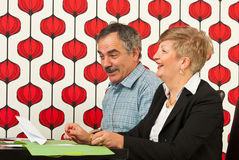 Laughing two mature business people Stock Photos