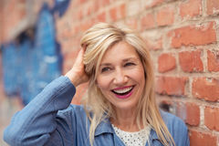 Laughing vivacious middle-aged woman Stock Photo