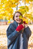 Laughing vivacious woman in an autumn park Royalty Free Stock Photography