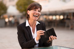 Laughing vivacious woman making a payment Stock Images
