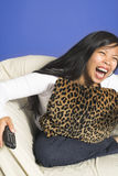 Laughing watching tv Royalty Free Stock Photos