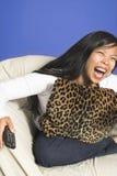 Laughing watching tv royalty free stock photos