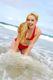 Laughing Wet Model. Photo of a model in the waves laughing Stock Image