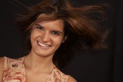 Laughing in the wind. Beautiful girl laughing with hair in the wind stock photography