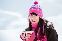 Laughing winter girl with the cup of tea Royalty Free Stock Photos