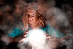 Laughing Witch with light sphere Stock Photos