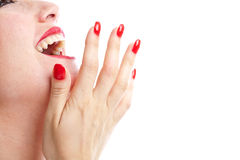 Laughing woman. Woman laughing out loud with her hand in front of her mouth Stock Photo