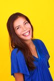 Laughing woman. Young mixed race person laughing on yellow background Royalty Free Stock Photo