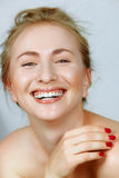 Laughing woman. Laughing beautiful young woman with fine laugh lines around her eyes Stock Image
