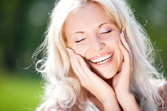 Laughing woman. Beautiful happy laughing woman outdoors on a warm summer day stock photo