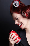 Laughing woman. Laughing young woman with a red jar Stock Photos
