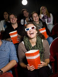 Laughing woman. Laughing women at the movie theater Royalty Free Stock Photos
