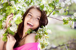 Laughing woman. Beautiful laughing brunette woman in the park on a warm summer day Stock Image