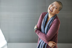 Laughing woman. Laughing Asian woman with shaved head looking at camera stock photography