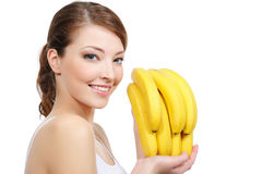 Laughing woman with bananas. Beautiful young laughing woman with bananas - white background Stock Photos