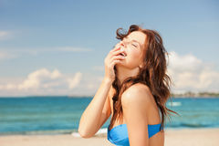 Laughing woman on the beach Royalty Free Stock Photography