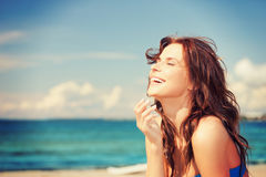 Laughing woman on the beach royalty free stock images
