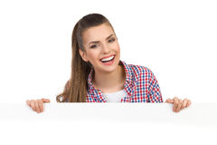Laughing Woman Behind White Placard Royalty Free Stock Images