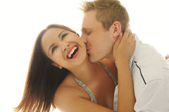 Laughing woman being kissed by her lover Royalty Free Stock Photo
