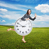 Laughing woman with big white clock Stock Photo