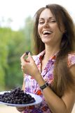 Laughing woman with blackberry. Laughing beautiful woman with blackberry Royalty Free Stock Photo