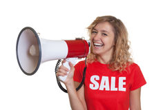Laughing woman with blond hair and megaphone. On an isolated white background for cut out Stock Image