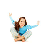 Laughing woman in blue pyjamas. Sitting on the floor Royalty Free Stock Image