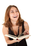 Laughing woman with a book. Beautiful woman with a book in hands is laughing Royalty Free Stock Photography