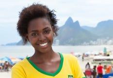 Laughing woman in brazilian jersey at Rio de Janeiro Royalty Free Stock Image