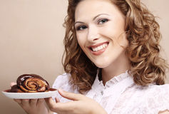 Laughing woman with cake Stock Photo