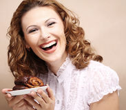 Laughing woman with cake Royalty Free Stock Image