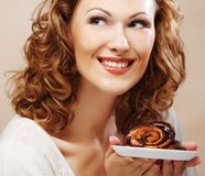 Laughing woman with cake Royalty Free Stock Photos