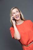 Laughing woman chatting on her mobile phone Royalty Free Stock Photography