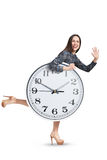 Laughing woman with clock running Stock Photos