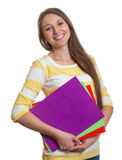 Laughing woman with colorful paperwork Royalty Free Stock Images