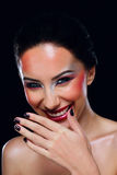 Laughing woman cover her mouth by hand Royalty Free Stock Images