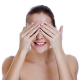Laughing Woman Covering Her Eyes Stock Photography